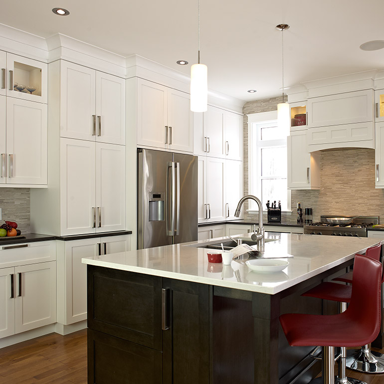 Transitional style kitchen with birch cabinets and quartz countertop